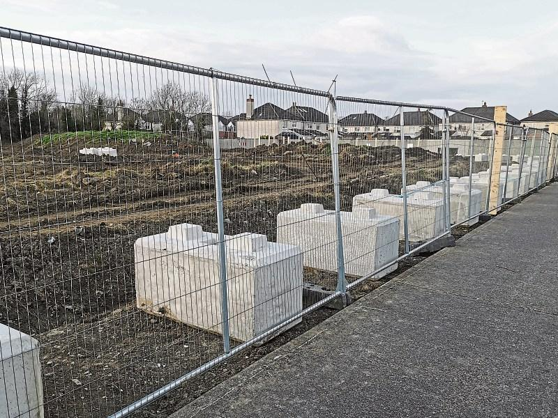 Dozens of locals protest at plans for 100m housing complex