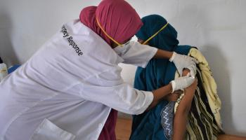 Pic: Supplied - Fartun Ali receiving the first dose of COVID 19 at Burdhubo Health Centre