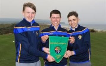 Naas CBS with the green pennant after winning the Irish Schools Junior Championship, from left - Darragh Behan, Eoin Freeman and Andrew Curran